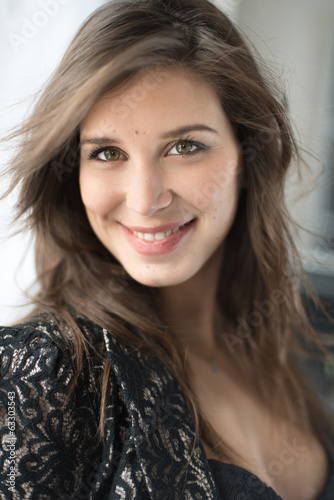 Smiling portrait of a fashionable young woman