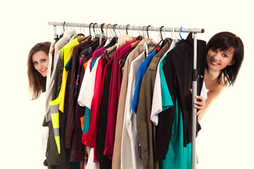 girlfriends choosing clothes, white background
