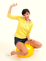 young woman with big, yellow ball
