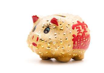 Gold  piggy bank isolated