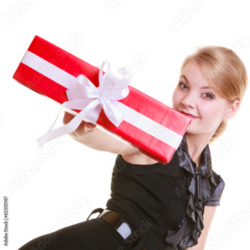 girl in black dress holding red christmas gift box. Holiday.