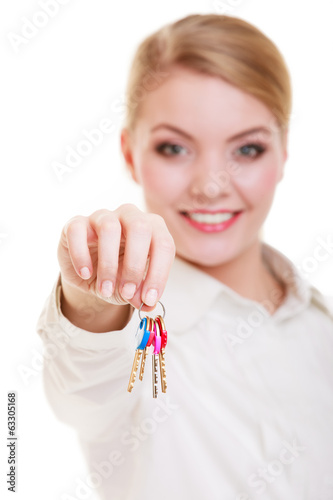 Happy woman real estate agent holding set of keys to new house
