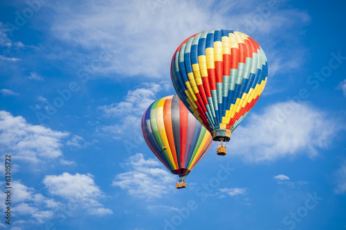 Leinwanddruck Bild Beautiful Hot Air Balloons Against a Deep Blue Sky