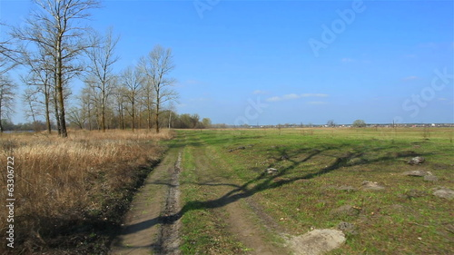 Rural road in steppe. Stabilized  view landscape.
