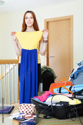 woman choosing dress for rest