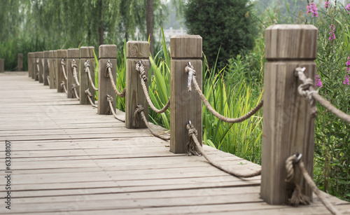 wooden path with railing in the park