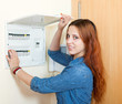 Smiling woman near power control panel