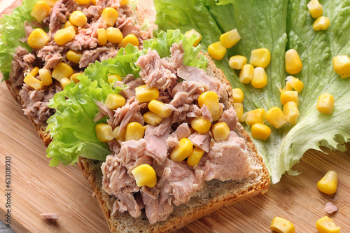 Sandwich with tuna and corn on wood
