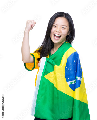 Excited asia woman draped with Brazil flag