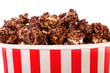 Chocolate coated popcorn in striped box for cinema