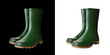 Green rubber boots on white background
