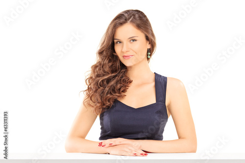 Beautiful girl sitting at a table