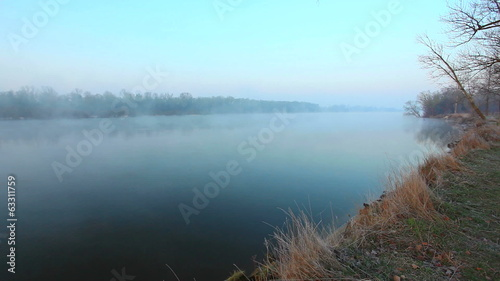 River mist. Beautiful morning landscape. Time lapse