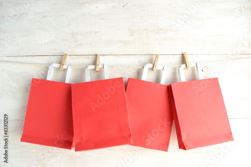 Red paper bags with clothes pins