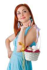 easter woman with a basket of eggs and pasky in hands. isolated.