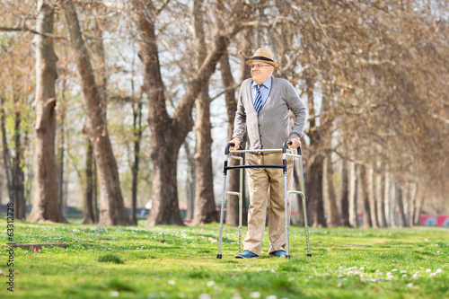 Senior gentleman walking with walker outdoors