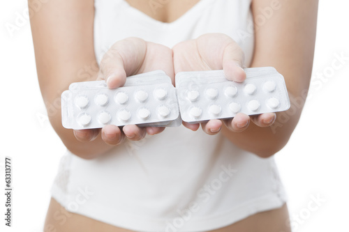 Pills in women hands