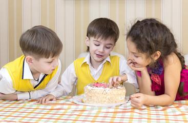 kids have fun eating birthday cake
