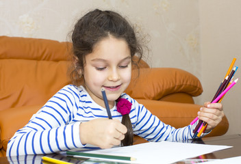 children draw with crayons on paper
