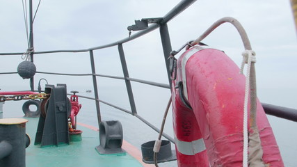 Deck of commercial fishing boat  in the misty sea