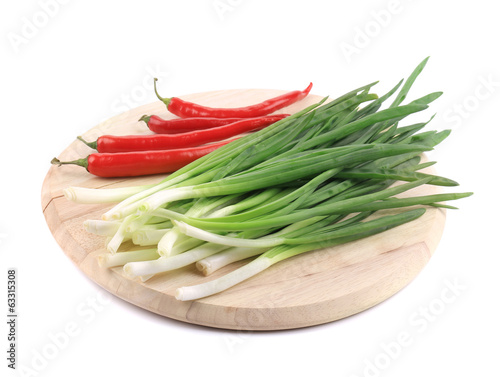 Bunch of green onion with red pepper