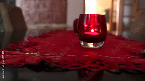 Three candles in red glass