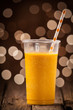 Glass of healthy orange mango smoothie