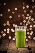 Green vegetable smoothie with party lights