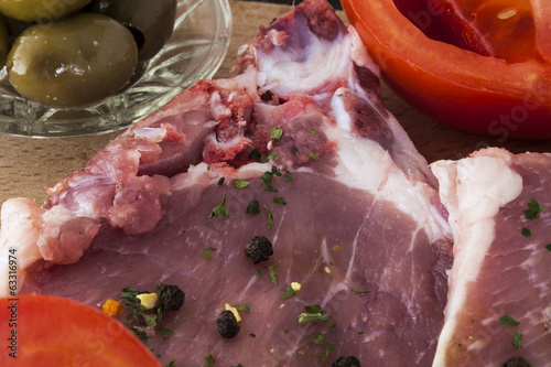 raw pork chops pepper olives and tomatoes