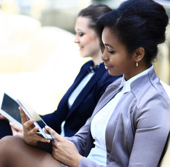 Businesswomen With Digital Table