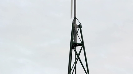 Large metal tower with the turbine on top