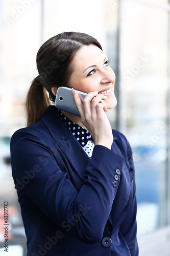 Business woman talking on her mobile phone
