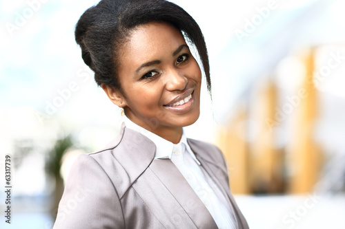 Casual african business woman looking happy and smiling