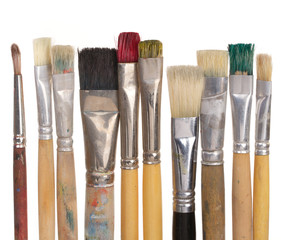 Assorted paintbrushes on white background