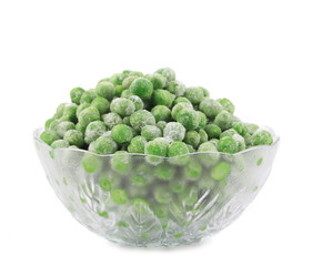 Glass dish with green frozen peas.