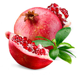 Ripe wet pomegranate with piece and leaves isolated on a white