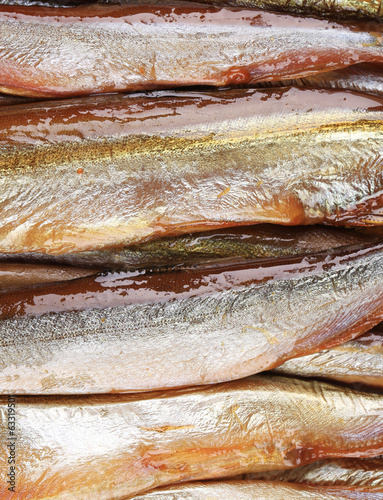 Smoke-dried fish close up.