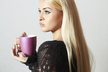 Beautiful blond woman with Coffee. Cup of tea. Hot drink