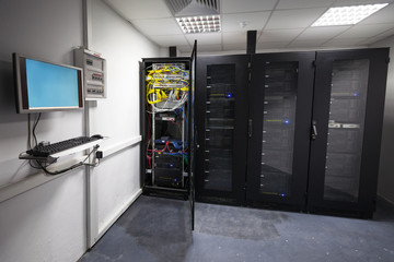 Modern server room interior with black computer cabinets