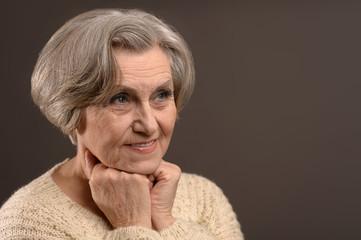 Elderly woman on black background
