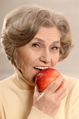 Mature woman with ripe apple