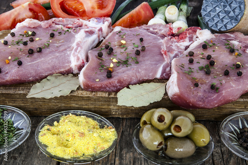 raw meat with spices and vegetables