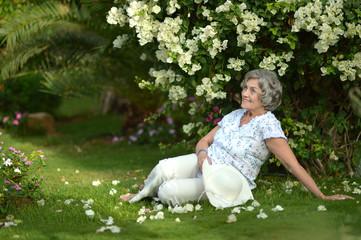woman sitting under bush