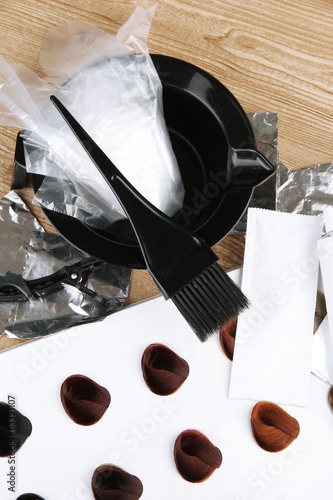 Hair dye kit and hair samples of different colors,