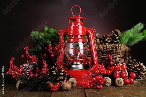 Red kerosene lamp on dark color background