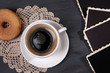 Coffee cup, donut and old blank photos, on wooden background