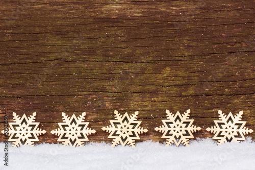 canvas print picture Sterne im Schnee vor Holz