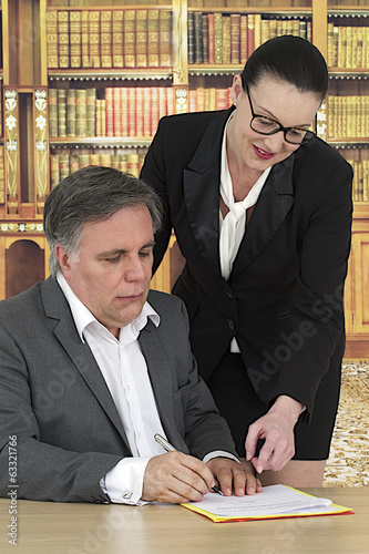assistant helping boss  for contract signature