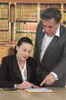 woman signing document with business man