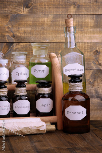 Historic old pharmacy bottles with label   on wooden background